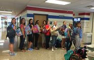 Community organizations donate 120 backpacks to area schools