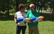 Two local non-profits gather for community celebration, water gun fight
