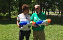 Two local non-profits gather for community celebration, water gun fight