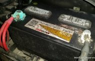 How can I maintain my car battery and keep it from corroding?