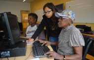 NOVA Woodbridge students help seniors with computer skills