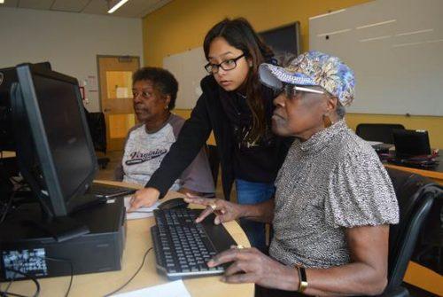 NOVA Woodbridge students help seniors with computer skills