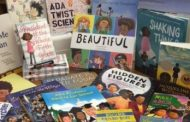 Sorority donates books to Chris Yung Elementary School