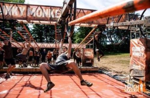 Tough mudder race featuring obstacles at local recreation park
