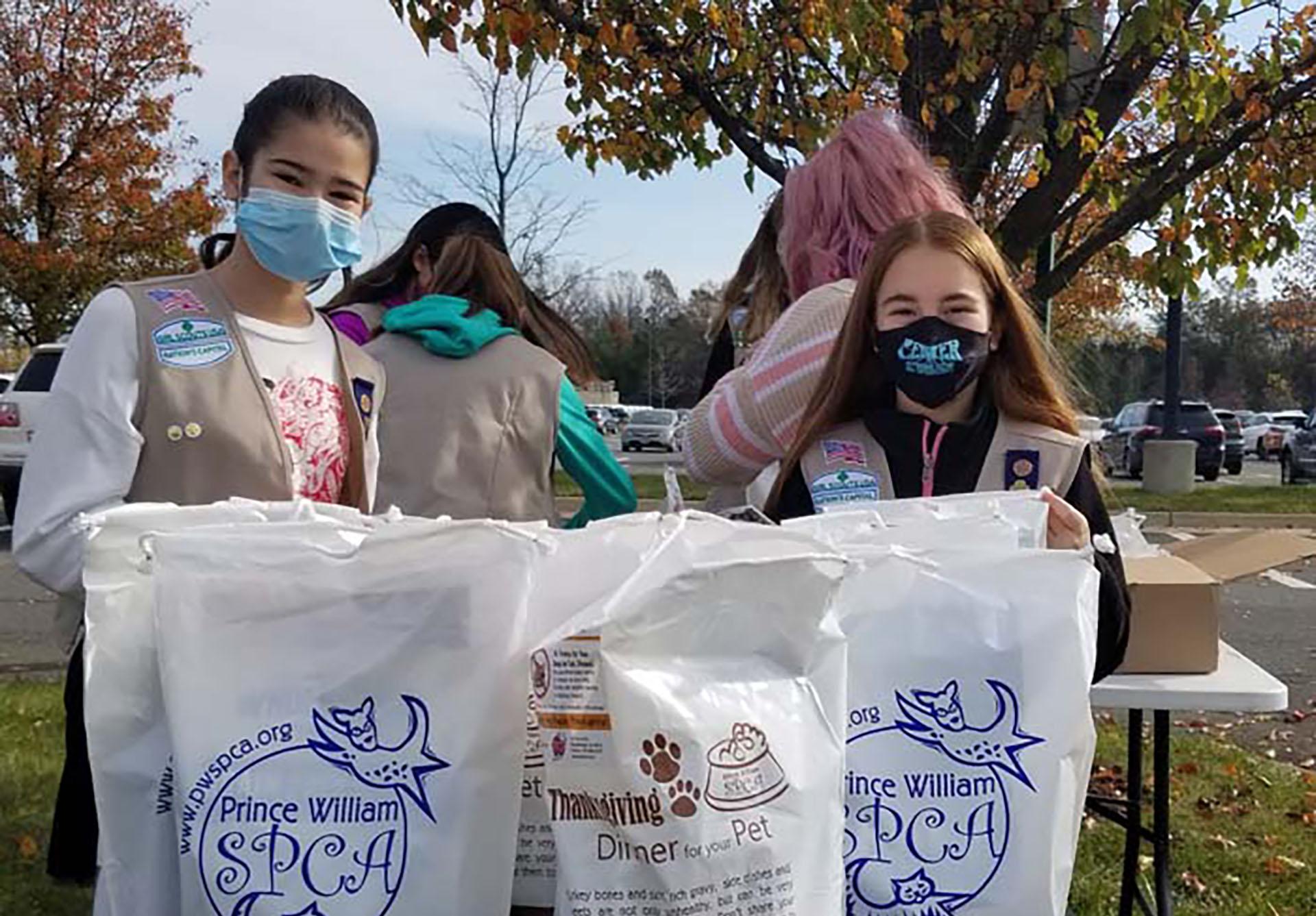 Prince William SPCA, girl scouts donate pet food