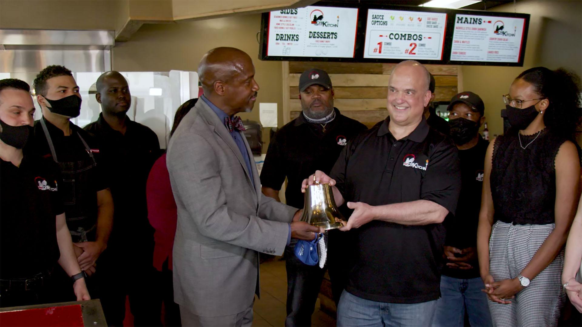 Neabsco District Supervisor provides bell to restaurant